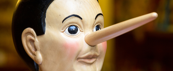 Wooden pinocchio doll with his long nose